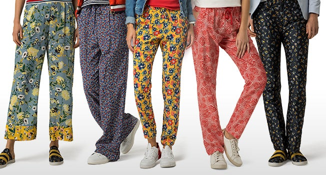 Assorted new season women's pants in an array of prints and colors.