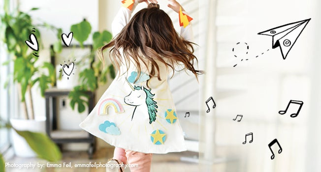 Read and Shop Kids: Craft Time Reimagined. Girl dressed in white jacket decorated with colorful, whimsical patches.