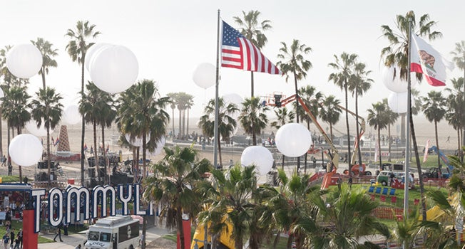 Aerial view of palm trees, runway and American flags from Tommyland in Los Angeles for Spring 2017 Fashion Show