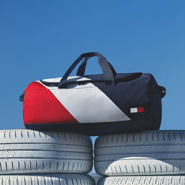 Colorblock duffel bag with diagonal red, white, and blue stripes.