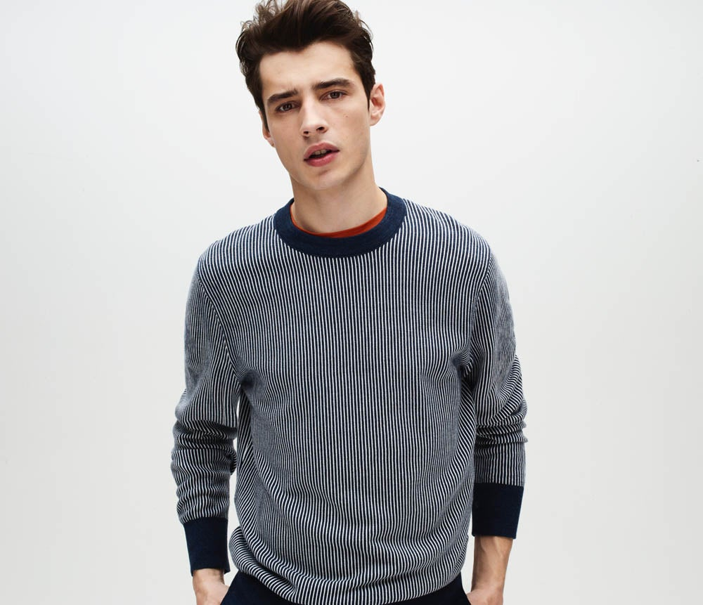 Sweater refresh. Textured fabrics and iconic prints are made modern in the slouchy new fits. Male model wearing a crewneck sweater.