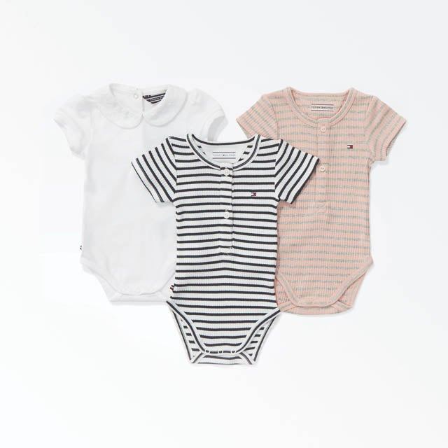 A blue and white striped top for babies with ruffled sleeves and floral embroidery.