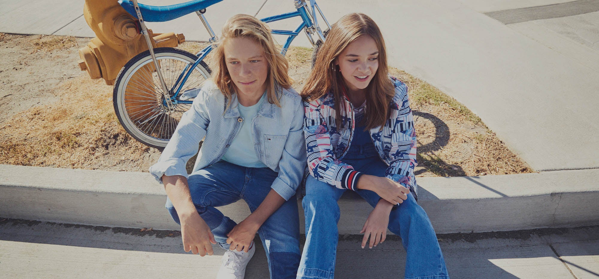 Jeans for teens. Patches. Frayed edges. Rip and repair. New Blues. Two teens wearing new denim styles.