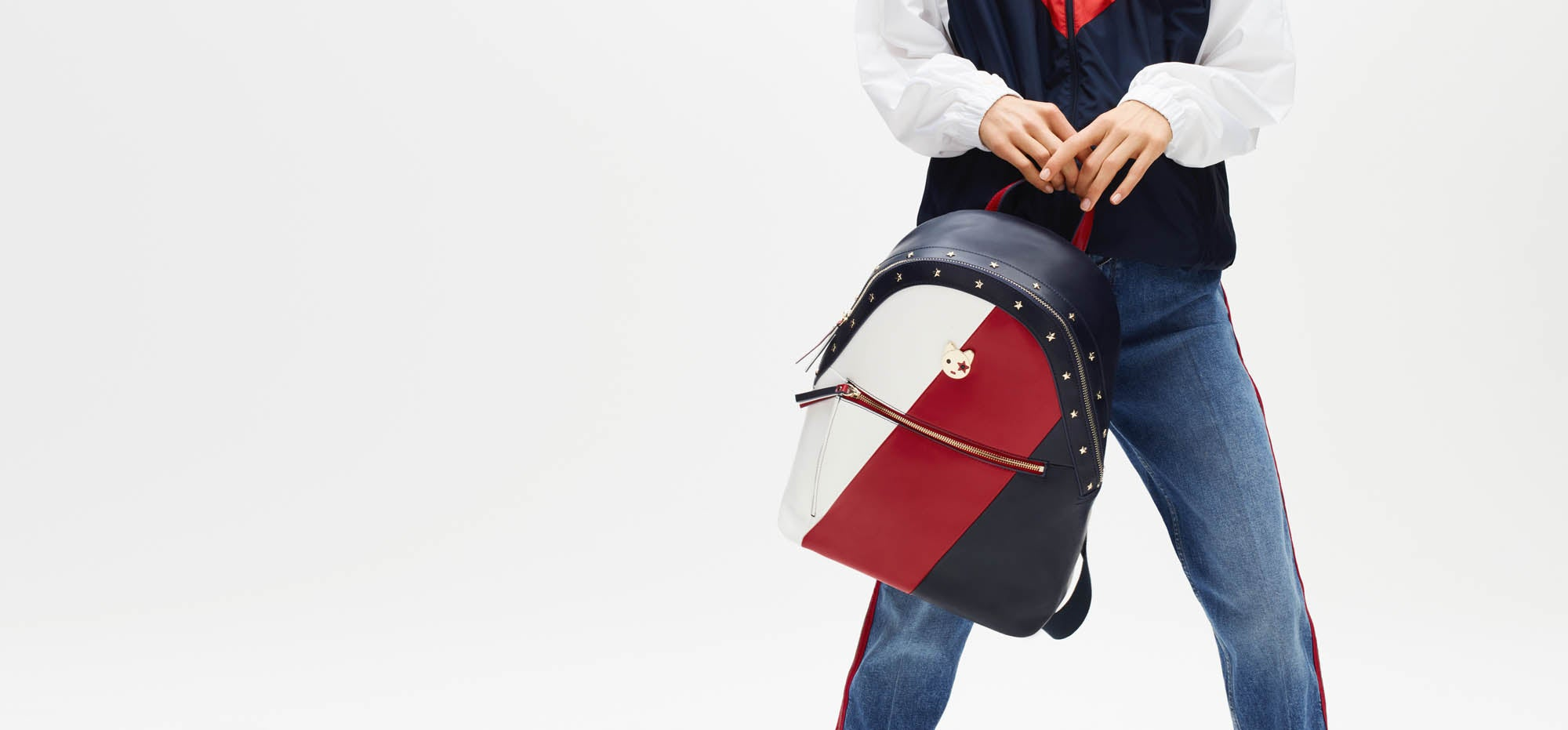 The backpack. One of many hands-free favorites for all the places you'll go. Model holds a red white and blue backpack.