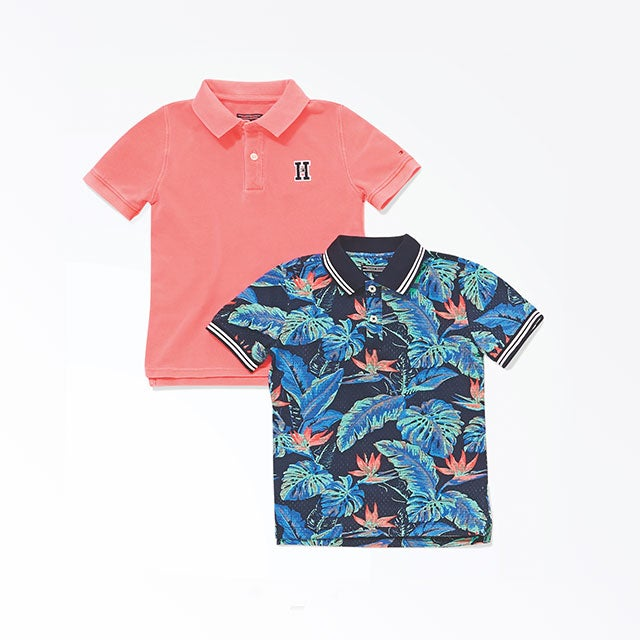 Two boys' polos in bright colors and tropical prints