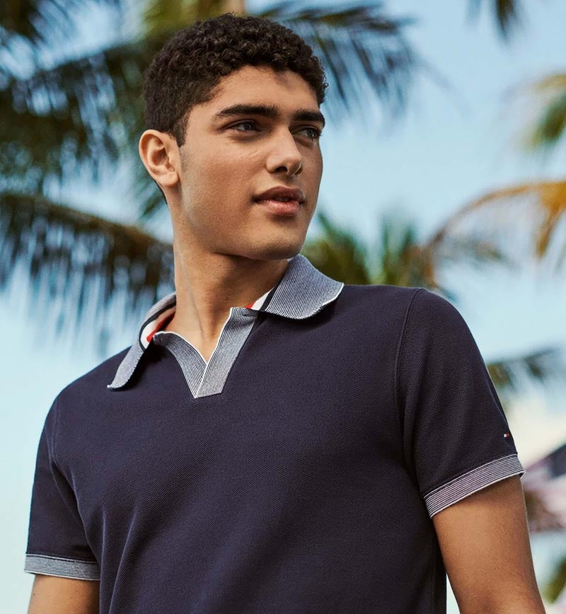 76e11253ffba Male model in polo with contrast trim from Tommy Hilfiger.