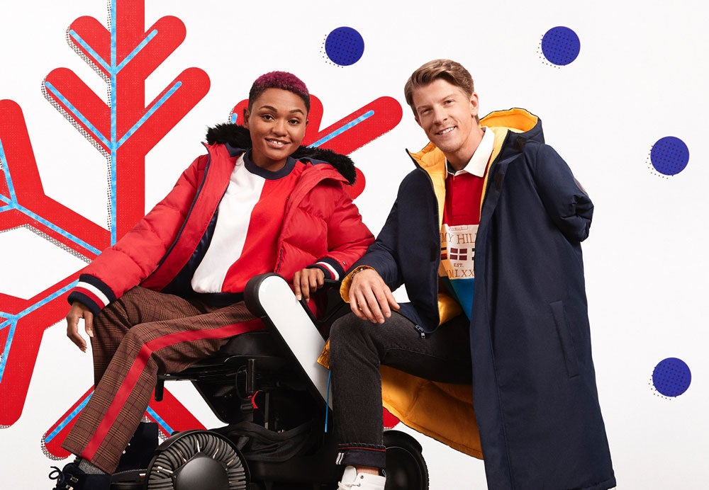 Male and female model wearing a holiday-ready dress from Tommy Hilfiger Adaptive, designed to make dressing easier.