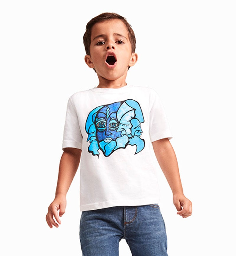 A boy model wears a graphic tee made in a sensory-friendly design from Tommy Hilfiger and Autism Speaks®.