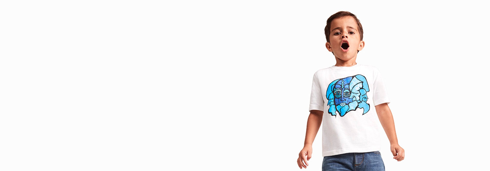 A boy model wears a graphic tee made in a sensory-friendly design from Tommy Hilfiger and Autism Speaks?.