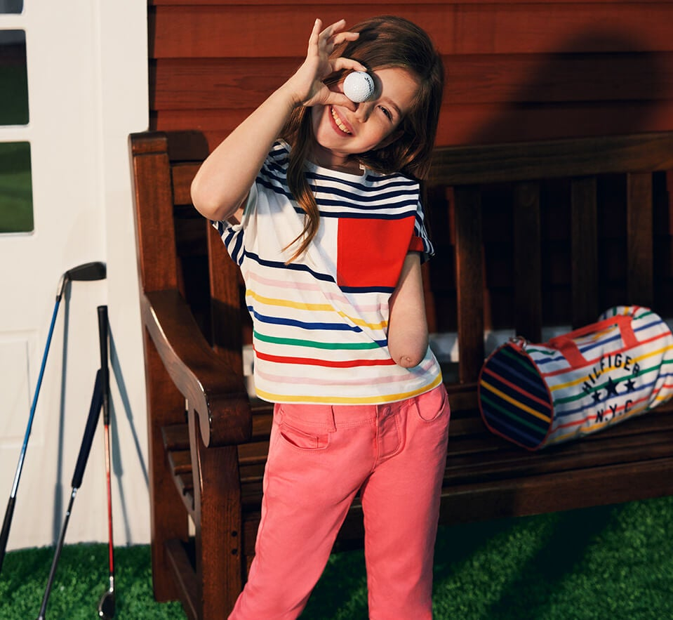 I Spy. Colorful tops and pants with clever features that make getting dressed a snap. Model wears colorful top and pants, specially designed for ease of dressing.