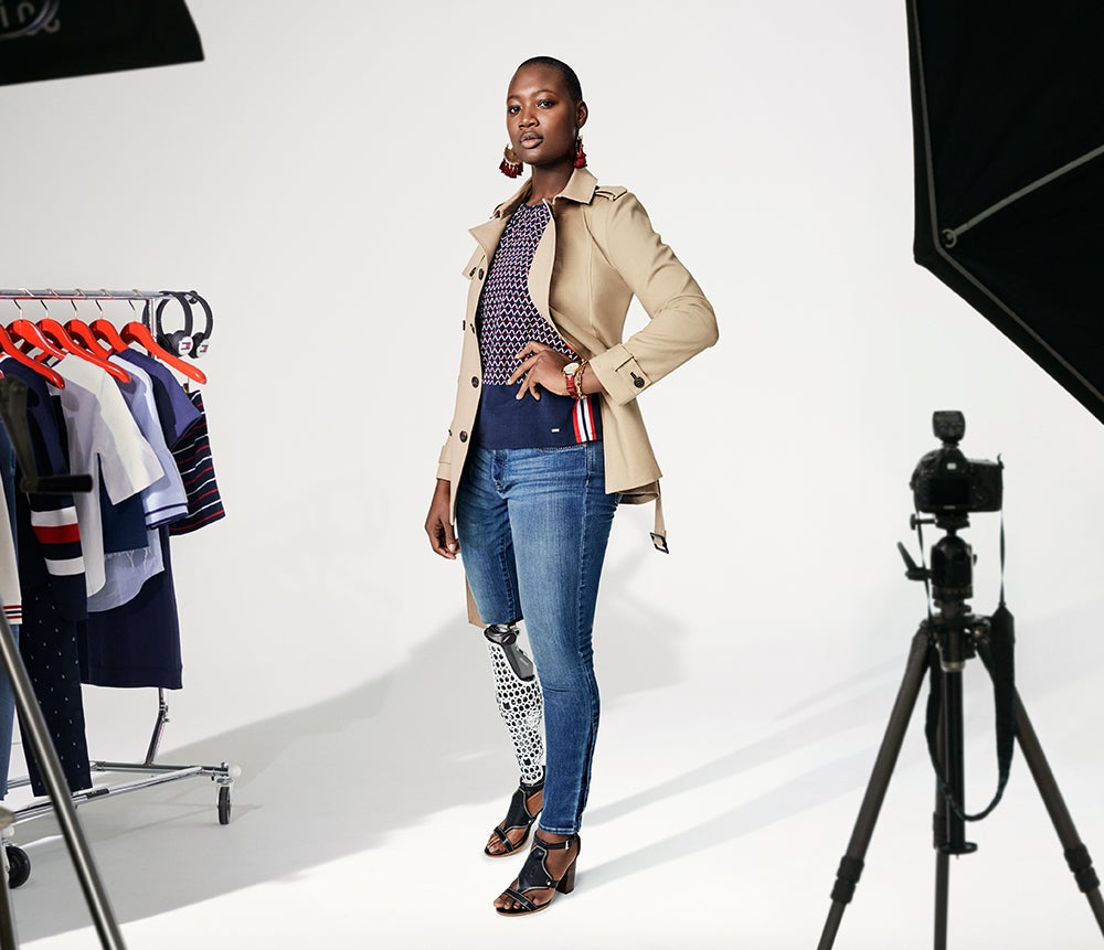 Own it. Statement-making fashion and essentials designed to be as bold as you choose. Female model wears classic  trench coat over top and jeans designed for ease of dressing.