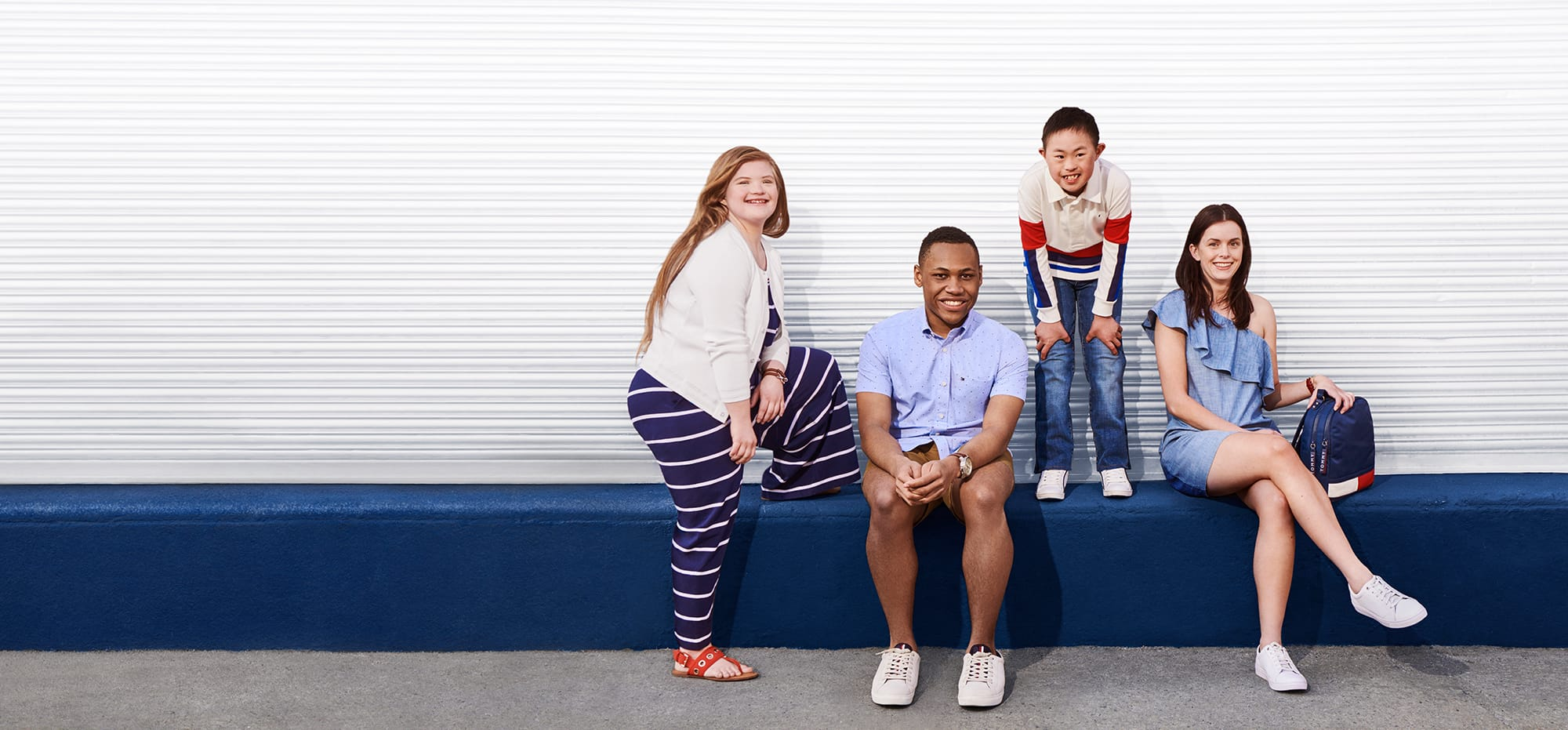 Tommy Hilfiger Adaptive. Inclusive design, fashion for all. Group of adult and child models wear classic Tommy style, specially designed to make dressing easier.