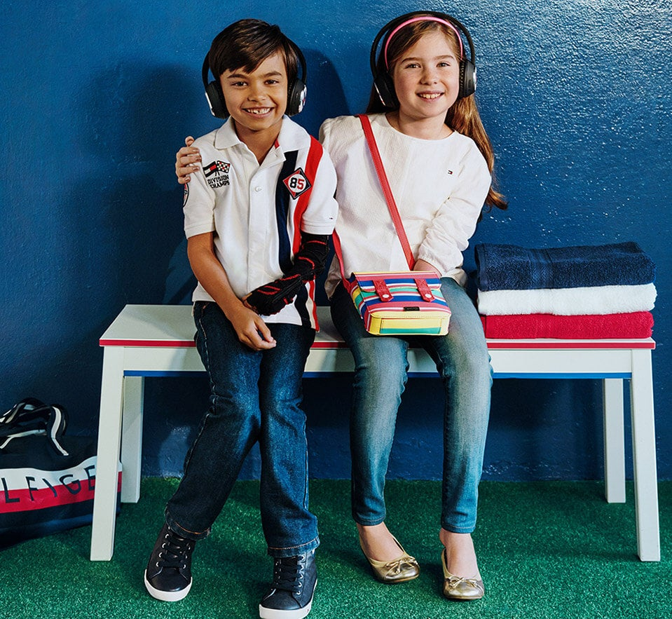 Driven by the promise of a fun day. Boy and girl wear classic Tommy apparel specially designed for ease of dressing.