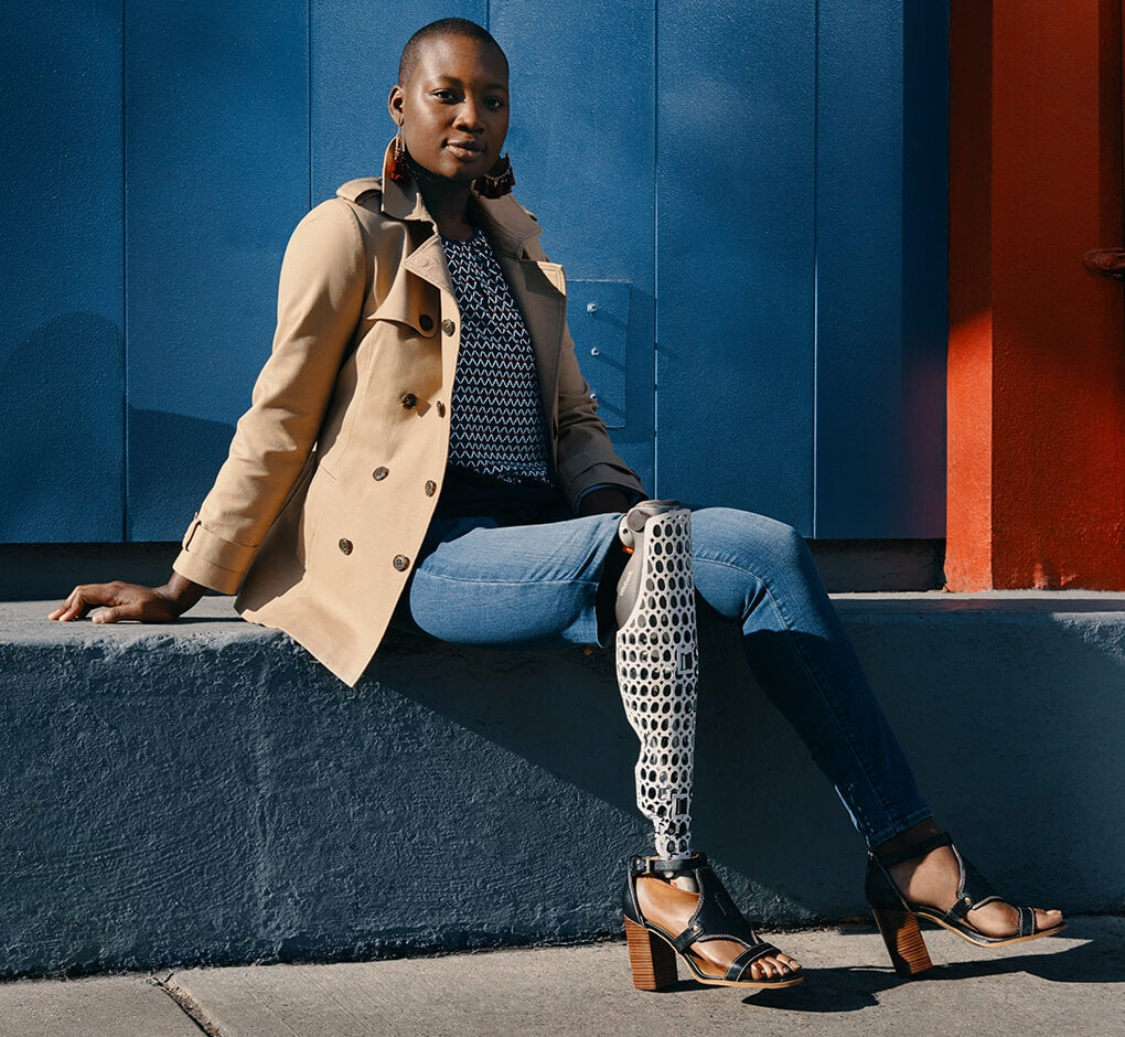 Driven by the need to look amazing every day. Female model wears classic trench, stripe top and jeans designed with innovations that make getting dressed easier.