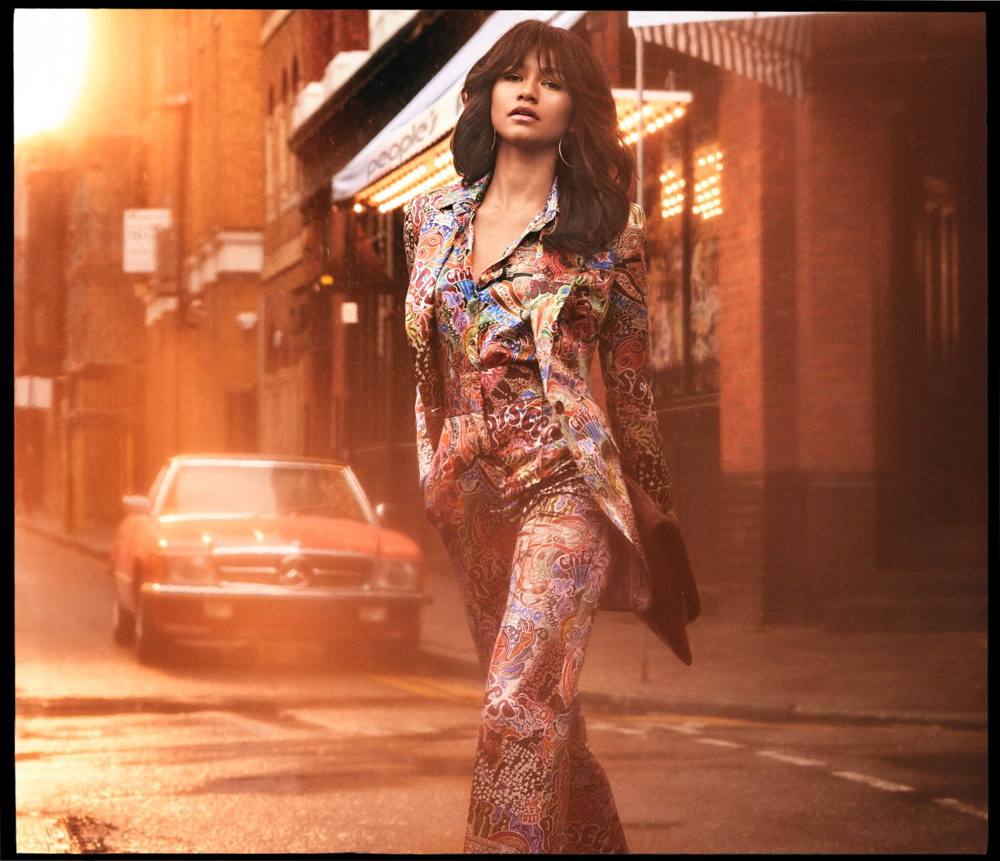 dedb50be Designed in a vibrant print, Zendaya wears a blouse, pant and jacket from  the